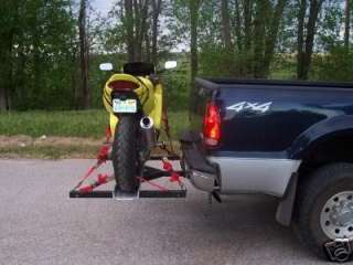 Trailer hitch mounted motorcycle carrier rack hauler
