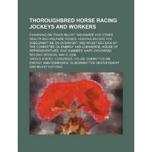 horse racing jockeys and workers examining on track injury