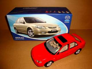 18 Mazda Family 323 red color